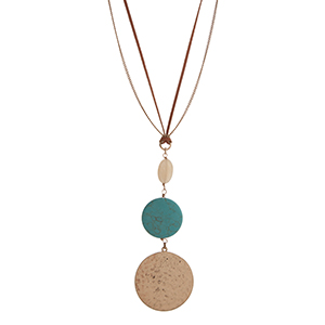 "Gold tone and brown cord necklace with an oval ivory stone, a round turquoise stone, and a hammered disk. Approximately 29"" in length. Overall length 33 1/2""."