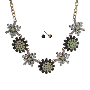 """Burnished gold tone necklace set displaying a green, black, and clear rhinestone floral casting. Approximately 16"""" in length."""