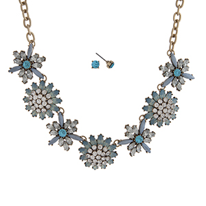 """Burnished gold tone necklace set displaying a blue and clear rhinestone floral casting. Approximately 16"""" in length."""