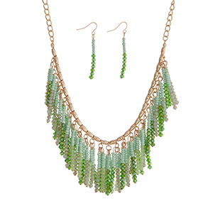 "Gold tone necklace set displaying a cluster of green and mint green beaded fringe. Approximately 18"" in length."