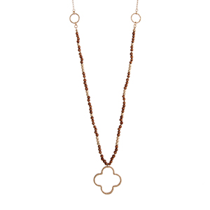 "Worn gold tone wood bead necklace with an open quatrefoil pendant. Approximately 29"" in length."