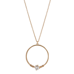 """Gold tone necklace displaying a ring with a wire wrapped clear rhinestone. Approximately 29"""" in length."""