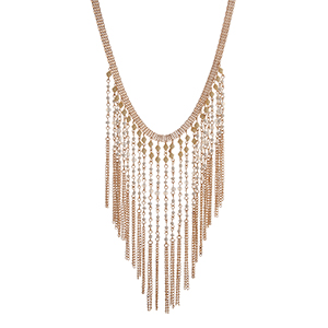 "Gold tone necklace displaying long white and yellow beaded chain fringe. Approximately 15"" in length."