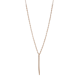 "Gold tone champagne glass bead linked spear necklace. Approximately 25"" in length."