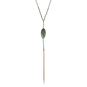 """Gold tone necklace displaying turquoise beads with an oval teal natural stone and chain tassel. Approximately 32"""" in length."""