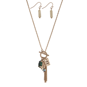 """Gold tone toggle necklace set displaying green stones and beads, a chain mini tassel, and a plate stamped """"True Love"""". Approximately 17"""" in length."""