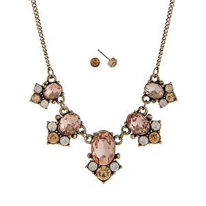 "Burnished gold tone necklace set displaying pink oval cabochons with round white and topaz rhinestone accents. Approximately 15"" in length."