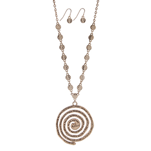 "Gold tone necklace set displaying hammered disk with a spiral pendant stamped with the Lord's Prayer. Approximately 24"" in length."