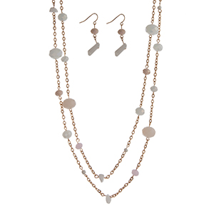 """Gold tone layering necklace set displaying white, pink, and peach beads and chipstone. Approximately 50"""" in length."""