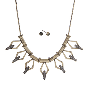 """Gold tone necklace set displaying a casting with open diamond shapes and black diamond cabochons. Approximately 17"""" in length."""