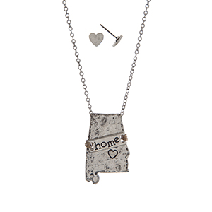 "Silver tone necklace set displaying the state of Alabama with a wire wrapped bar stamped ""home"". Approximately 19"" in length."