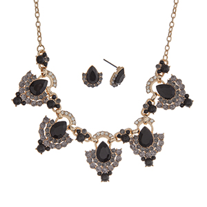 """Gold tone necklace set displaying black teardrop shape cabochons surrounded by rhinestones. Approximately 18"""" in length."""