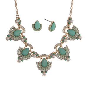 "Gold tone necklace set displaying mint green teardrop shape cabochons surrounded by rhinestones and faux pearl accents. Approximately 18"" in length."