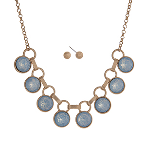 "Matte gold tone necklace set displaying blue opal round rhinestones. Approximately 16"" in length."