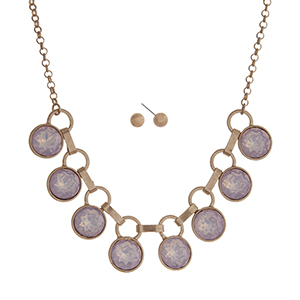 "Matte gold tone necklace set displaying pink opal round rhinestones. Approximately 16"" in length."