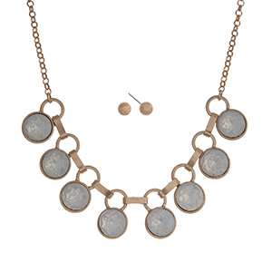 "Matte gold tone necklace set displaying white opal round rhinestones. Approximately 16"" in length."