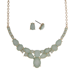 "Gold tone necklace set displaying multiple shape mint green cabochons. Approximately 16"" in length."