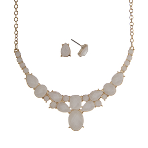 """Gold tone necklace set displaying multiple shape ivory cabochons. Approximately 16"""" in length."""