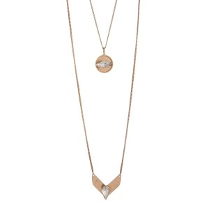 """Worn gold tone layering necklace displaying a disk and a chevron with clear cabochons. Approximately 28"""" in length."""