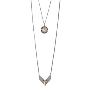 """Burnished silver tone layering necklace displaying a disk and a chevron with clear cabochons. Approximately 28"""" in length."""