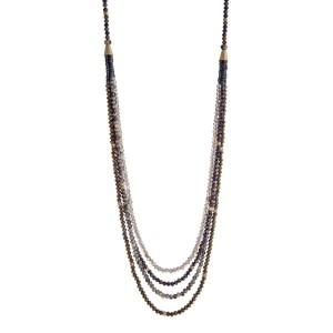 "Gold tone necklace displaying rows of layered gray and navy beads. Approximately 33"" in length."