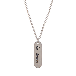 "Silver tone necklace displaying a plate stamped ""Be brave"". Approximately 17"" in length."