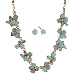 "Gold tone necklace set displaying mint green roses surrounded by multiple shaped mint cabochons. Approximately 17"" in length."