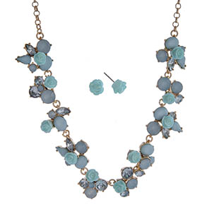 "Gold tone necklace set displaying blue roses surrounded by multiple shaped blue cabochons. Approximately 17"" in length."