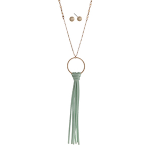 "Gold tone necklace set displaying a mint 6"" tassel on a ring. Approximately 32"" in length."