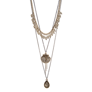 "Gold tone layering necklace displaying gray dangling beads, a seashell charm, and a teardrop shape topaz stone. Approximately 24"" in length."
