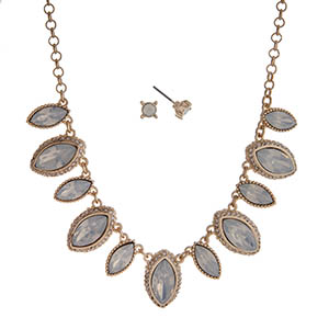 "Gold tone necklace set displaying white opal marquee shape cabochons. Approximately 15"" in length."