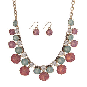"Gold tone necklace set displaying round pink, mint, clear, and gray rhinestones. Approximately 16"" in length."
