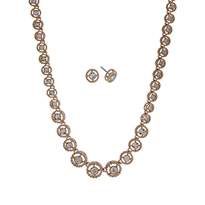 "Gold tone necklace set displaying clear round rhinestones. Approximately 16"" in length."