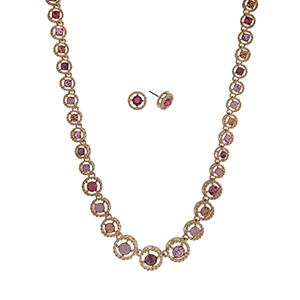 "Gold tone necklace set displaying pink, purple, and peach round rhinestones. Approximately 16"" in length."