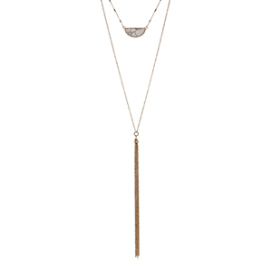 "Gold tone double layer necklace with a howlite crescent pendant and a chain tassel. Approximately 32"" in length."