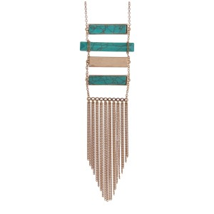 "Gold tone necklace with turquoise bar pendants and gold tone chain fringe. Approximately 32"" in length."