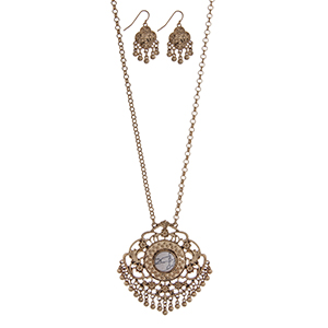 """Gold tone necklace set with a Marrakesh pendant accented with a howlite stone and metal fringe. Approximately 32"""" in length."""