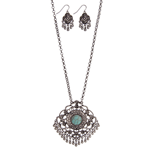 """Silver tone necklace set with a Marrakesh pendant accented with a turquoise stone and metal fringe. Approximately 32"""" in length."""
