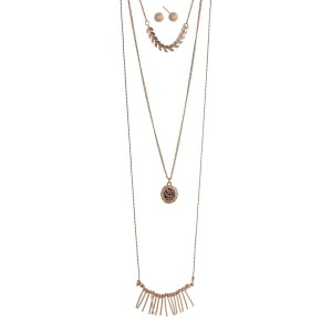 "Worn gold tone triple layered necklace set with gray rhinestones, metal fringe, and arrow details. Approximately 30"" in length."