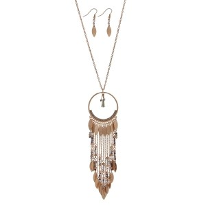 "Gold tone necklace set featuring a circle pendant with iridescent beads, metal fringe details. Approximately 36"" in length."