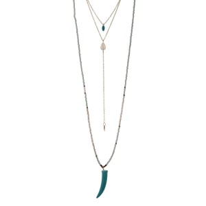 """Gold tone triple layer necklace with turquoise and pink beads featuring a horn pendant. Approximately 36"""" in length."""