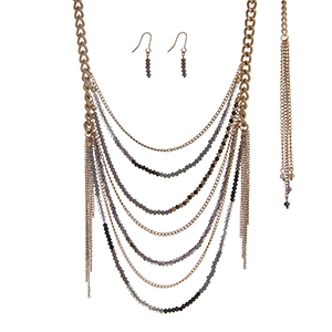 "Gold tone necklace set with gray and black beaded chains. Approximately 30"" in length."