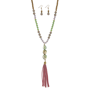 "Wooden beaded necklace set with a green natural stone pendant and pink faux suede tassel. Approximately 32"" in length."