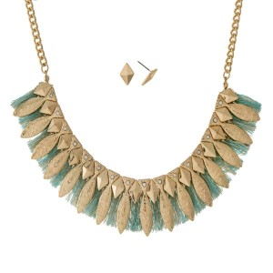 "Gold tone necklace set with an Aztec design and mint green fringe. Approximately 16"" in length."