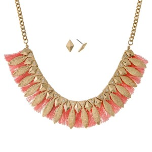 "Gold tone necklace set with an Aztec design and peach fringe. Approximately 16"" in length."