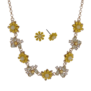 "Gold tone necklace set with yellow flowers accented by clear rhinestones. Approximately 16"" in length."