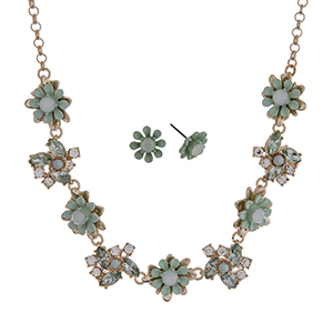 "Gold tone necklace set with mint green flowers accented by clear rhinestones. Approximately 16"" in length."