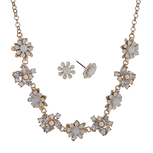 "Gold tone necklace set with white flowers accented by clear rhinestones. Approximately 16"" in length."
