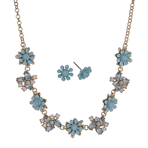 "Gold tone necklace set with aqua flowers accented by clear rhinestones. Approximately 16"" in length."