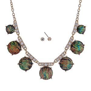 "Gold tone necklace set with shimmering round abalone stones accented with clear rhinestones. Approximately 16"" in length."